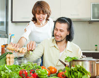 Friendly married couple preparing a meal of vegetables Royalty Free Stock Photo