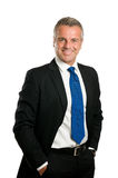 Friendly mature businessman. Friendly and confident mature businessman looking at camera and smiling isolated on white background Royalty Free Stock Image