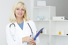 Friendly mature female doctor Royalty Free Stock Image