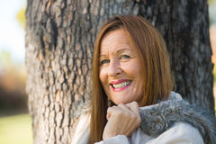 Friendly Mature woman winter jackte outdoor Stock Photo