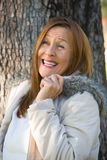 Friendly Mature woman winter jackte outdoor Royalty Free Stock Photos