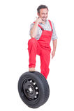 Friendly mechanic making call me gesture Stock Photos