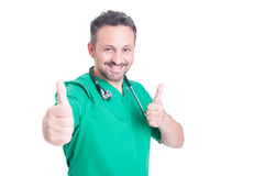 Friendly medical doctor showing double like sign Royalty Free Stock Image