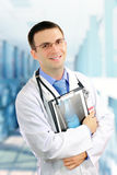 Friendly medical doctor with a x-ray image. Royalty Free Stock Photo