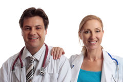 Friendly medical doctors. Medical healthcare professionals in uniform stand casually together with relaxed friendly smiles Stock Images