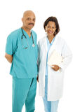 Friendly Medical Team. Friendly, attractive African American medical doctors.  Isolated on white Royalty Free Stock Photos