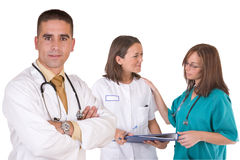 Friendly medical team. Healthcare workers - over a white background Stock Photos