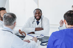 Friendly medical team discussing human health Stock Image