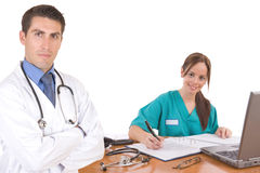 Friendly medical team - Healthcare workers. Over a white background Royalty Free Stock Photo