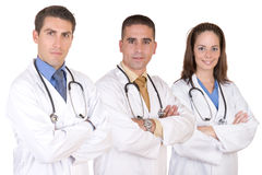 Friendly medical team - Healthcare workers. Over a white background Royalty Free Stock Photos