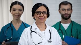 Friendly medical team, specialized doctor and nursing staff emergency department. Stock photo royalty free stock photos