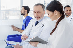Friendly medical team working together at clinic Royalty Free Stock Photos