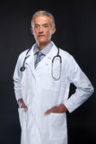 Friendly middle age doctor. Royalty Free Stock Images