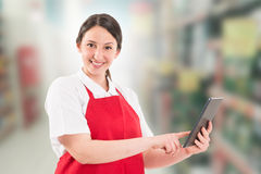 Friendly and modern hypermarket employee Stock Images