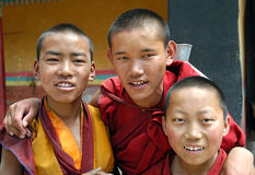 Friendly Monks In Tibet. Portrait of Tibetan monks or lamas at a lamasery in Tibet, China Royalty Free Stock Images