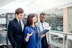 Multinational, business team having discussion on note in office. Friendly multinational, business team having discussion on note in office Stock Photo
