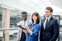 Multinational, business team having discussion on note in office. Friendly multinational, business team having discussion on note in office Stock Photos