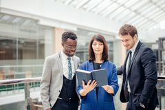 Multinational, business team having discussion on note in office. Friendly multinational, business team having discussion on note in office Stock Photography