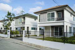 Friendly neighborhood. With steel fence and street stock image
