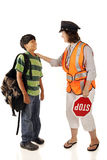 Friendly Neighborhood Crossing Guard. A friendly school crossing guard interacting with a preteen student. Isolated royalty free stock photo