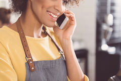 Friendly nice girl is talking on mobile phone stock photo