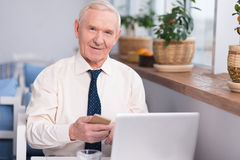 Friendly nice manager working in a cafe Royalty Free Stock Photography