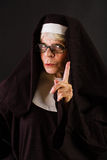 Friendly nun gesturing to wait Royalty Free Stock Photos