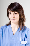 Friendly nurse. Smiling and looking to camera stock photos