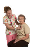 Friendly Nurse Check Elderly Senior Isolated Royalty Free Stock Photos