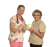 Friendly Nurse Helping Elderly Senior Isolated Stock Photo