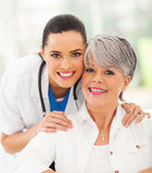 Friendly nurse senior patient Stock Photography