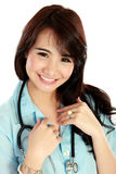 Friendly nurse smiling to the camera Royalty Free Stock Images