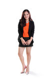 Friendly office lady full body. Friendly young Asian office lady standing and smiling at camera, full body shot  on white background Stock Photography