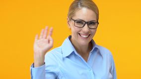 Friendly office manager waving hand, saying hello to new colleagues, invitation stock footage