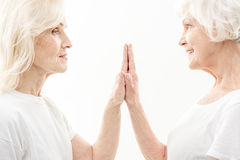 Friendly old ladies take care of each other Stock Photography