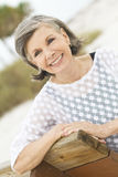 Friendly older woman. A beautiful older woman relaxing Royalty Free Stock Image