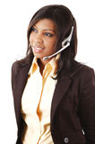 Friendly Operator. This is a close-up image of a female call operator. This image can be used for telecommunication and service themes Stock Photography