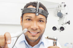 Friendly Otolaryngologist Doctor from patients perspective Royalty Free Stock Image