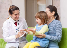 Friendly pediatrician doctor examining baby Stock Photography