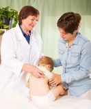 Friendly pediatrician doctor examining baby Royalty Free Stock Photo
