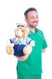 Friendly pediatrician doctor with teddy bear Stock Images