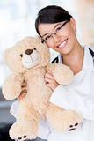 Friendly pediatrician smiling Stock Photography