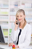 Friendly pharmacist portrait talking at the phone Stock Image