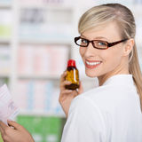 Friendly pharmacist with prescription and pills Stock Photo