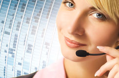Friendly phone operator. On blue abstract background Royalty Free Stock Photo