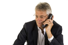 Friendly phonecall. Senior manager had a friendly telephone call Stock Photo