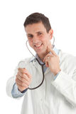 Friendly playful doctor holding out a stethoscope Royalty Free Stock Images
