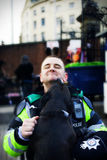 Friendly Police Officer. Friendly Police Officer being licked by a dog in the street. (Avon and Somerset Constabulary Bristol UK Royalty Free Stock Photo