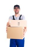 Friendly postman with parcels Stock Photo