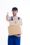 Friendly postman with parcels and thumb up Stock Photos